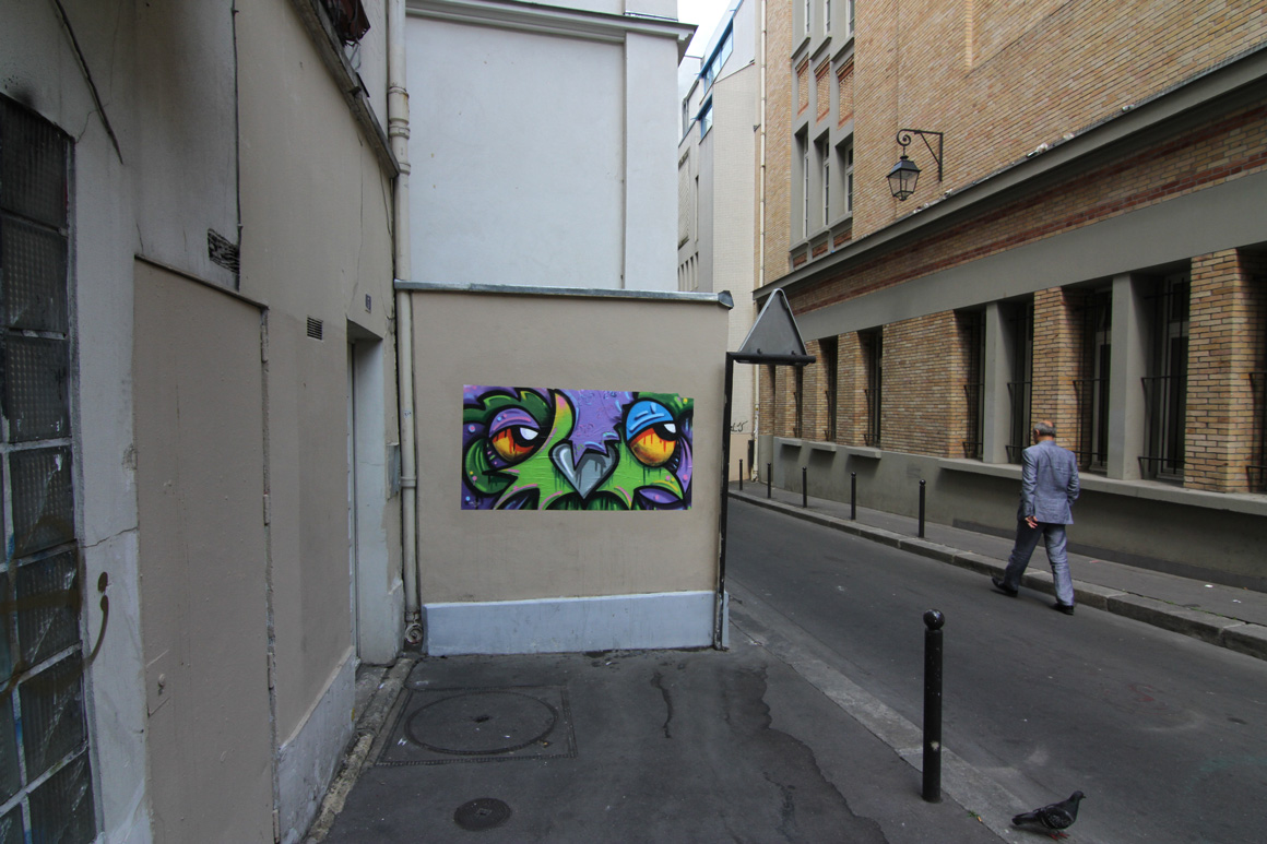 Nite Owl street art wheat paste in Paris, France